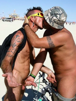 Black and white men nudists on the beach
