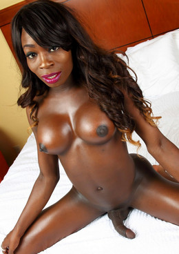 Be fan of this busty black tranny, she..