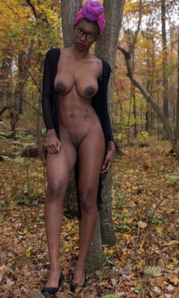 Tall ebony model with big nipples..